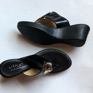 LizFlex Wedge Black Sandals with Silver Flower